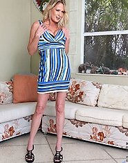 Naughty blonde housewife Bridgette Lee slowly removes her sexy sundress