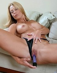 Bare skinned Brenda James spreads her pussy lips before drilling her juice box with a stiff dildo