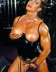 Muscular woman with big tits posing in gym