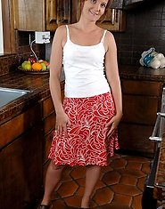 Naughty mature housewife teases and flaunts her panties in the kitchen