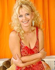 Enticing curly haired blonde anilos shows off her perky mature rack
