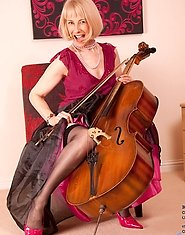 Seductive Anilos musician Hazel strips out of her evening wear after she plays her cello