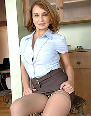 Milf babe Rebecca Bardoux slips off her office attire revealing her sexy bra and thong