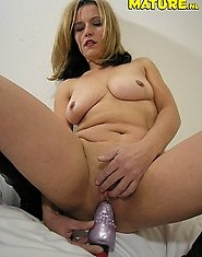 This nasty housewife loves her purple toy