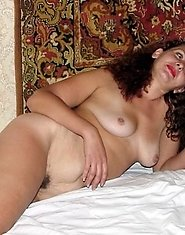 Horny mature showing hairy pussy